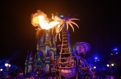Maleficent, the Steampunk-inspired dragon, breathes fire as she moves through Magic Kingdom Park during the Disney Villains After Hours event at Walt Disney World Resort in Lake Buena Vista, Fla. This separately ticketed, wickedly fun event occurs on select nights this summer. (Preston Mack, photographer)